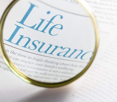 Life Insurance on magazine with magnifying glass. ++All text written by photographer++